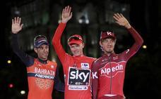 Froome gana su primera Vuelta y Trentin impone su ley en Madrid