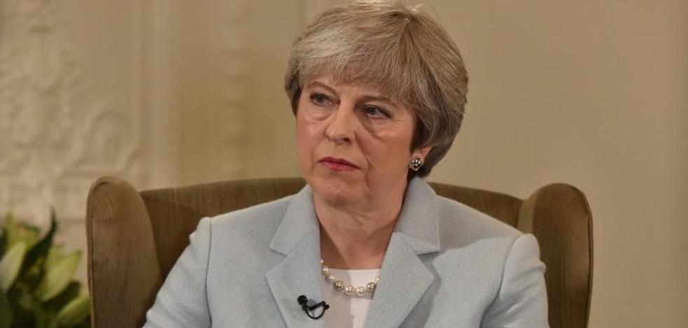 Theresa May confirma un reajuste inminente de su Gobierno