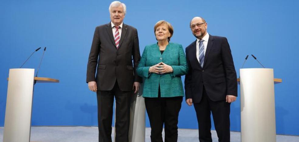 Merkel y Schulz pactan una gran coalición para gobernar Alemania