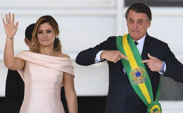 Michelle de Paula Firmo junto a Jair Bolsonaro  Efe