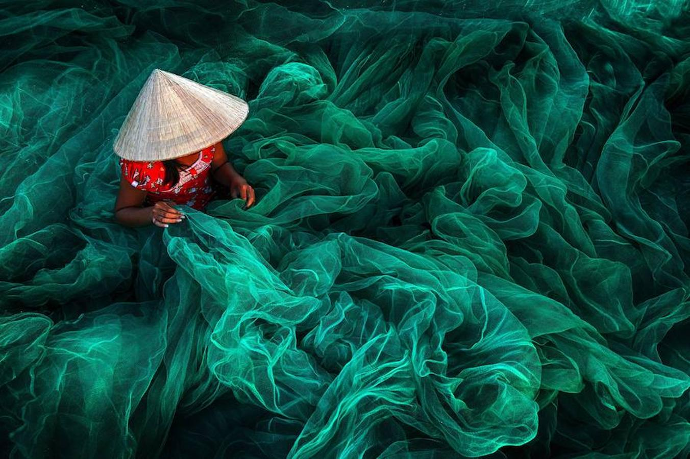 Making fishing nets, Vietnam