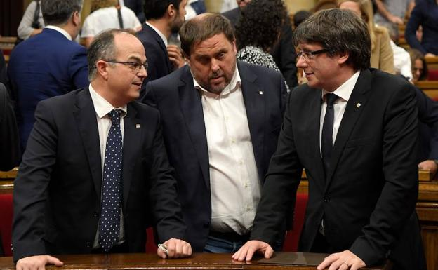 Turull, Junqueras y Puigdemont./Afp