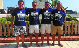 Los hermanos Postigo logran cruzar a nado el Estrecho contra el cáncer