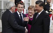 Macron, Merkel y Juncker muestran un frente unido ante las ambiciones chinas