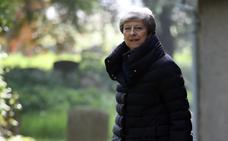 May y los conservadores negocian la fecha de su retirada