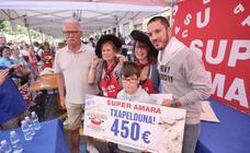 Concurrido concurso de merluza en la calle Matia