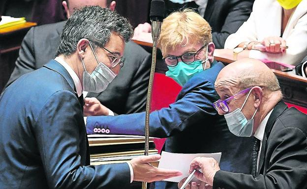 Interior Minister Gérald Darmanin (right) at the parliamentary session on Tuesday.