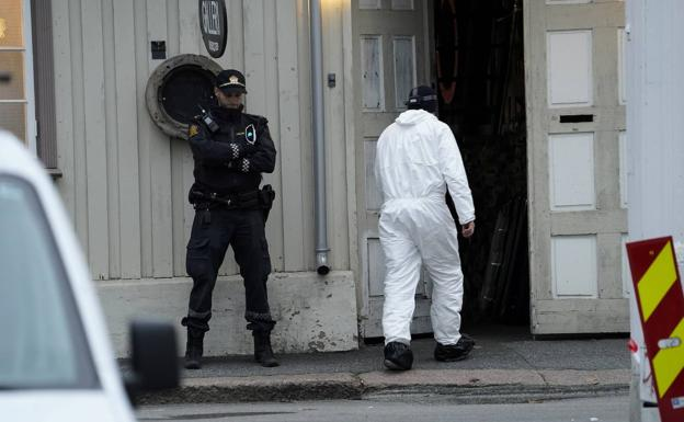 Scientific police collect evidence at the scene of the attack, in the Norwegian city of Kongongsberg